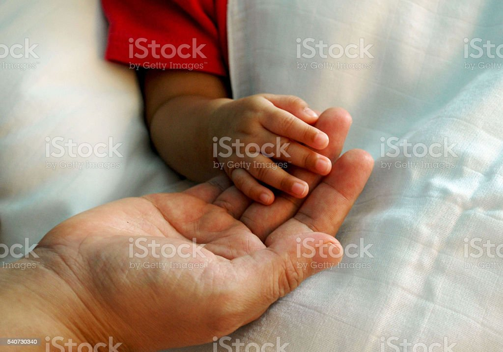 warmly touch,mother's hand with baby's hand stock photo