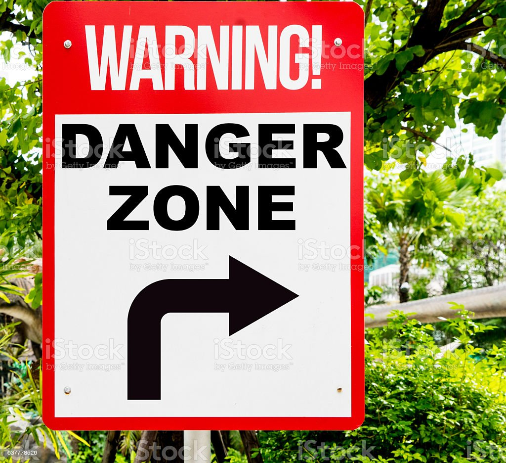 Warning Danger Zone red signage in forest. stock photo