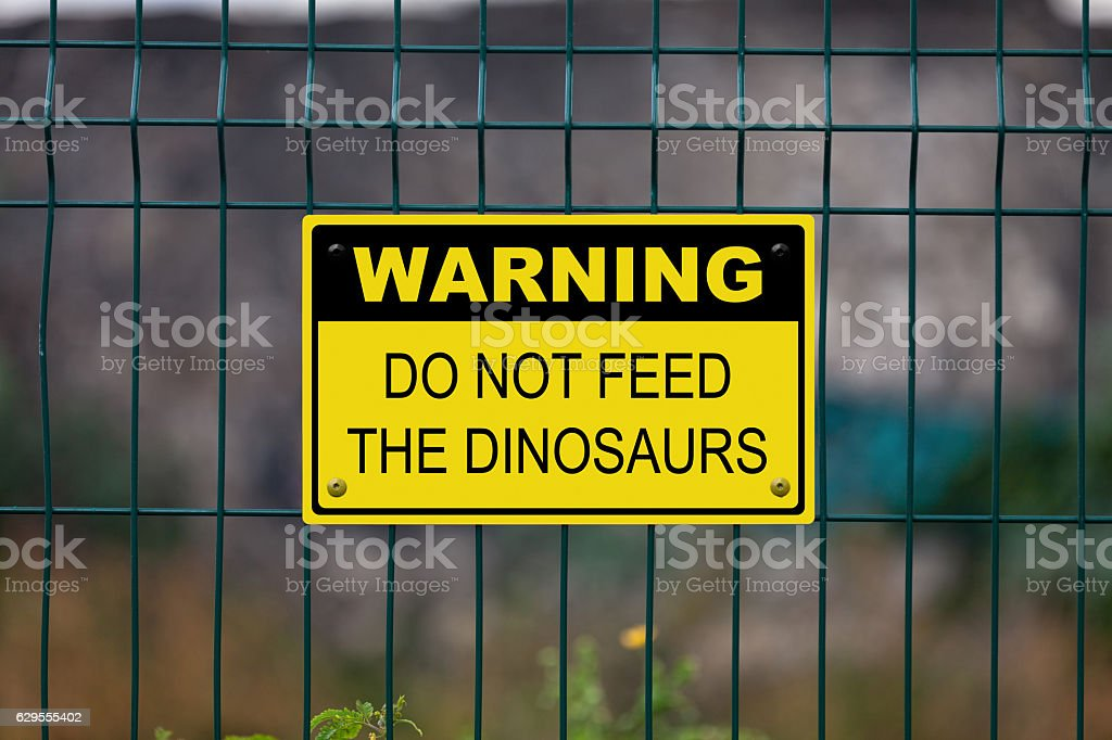 Warning - Do not feed the dinosaurs stock photo