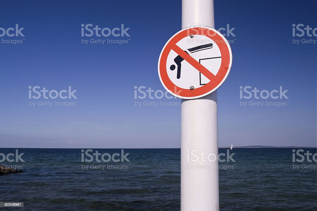 Warning - dont jump into the sea stock photo