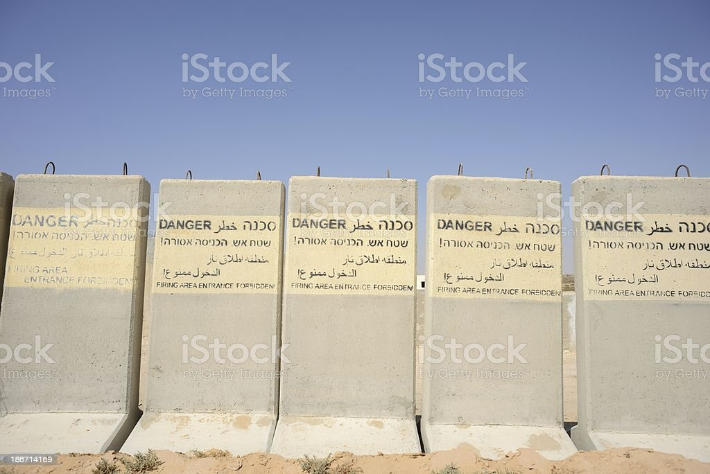 Warning messages on the protective concrete barriers royalty-free stock photo
