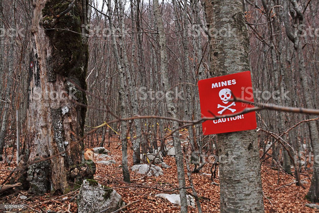 Warning minefield stock photo