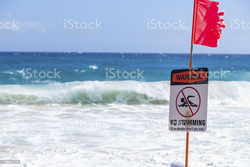 Warning no swimming sign, Sandy beach, Oahu, Hawaii stock photo