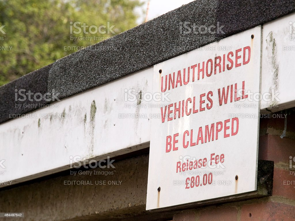 Warning notice about clamping for unauthorised parking stock photo