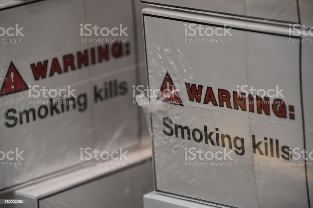 Warning on a pack of cigarettes stock photo