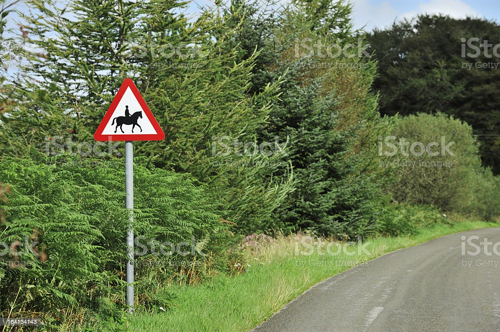 Warning road sign on rural road in Scotland royalty-free stock photo