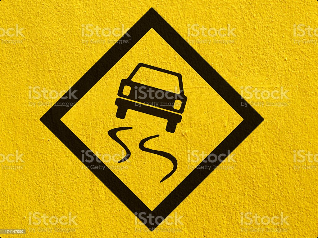 warning Road Sign painted on a stucco wall outside stock photo