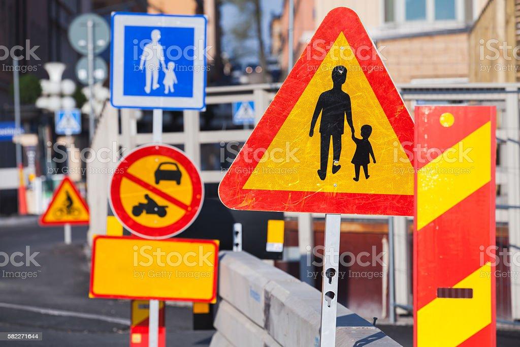 Warning roadsigns along European urban road stock photo