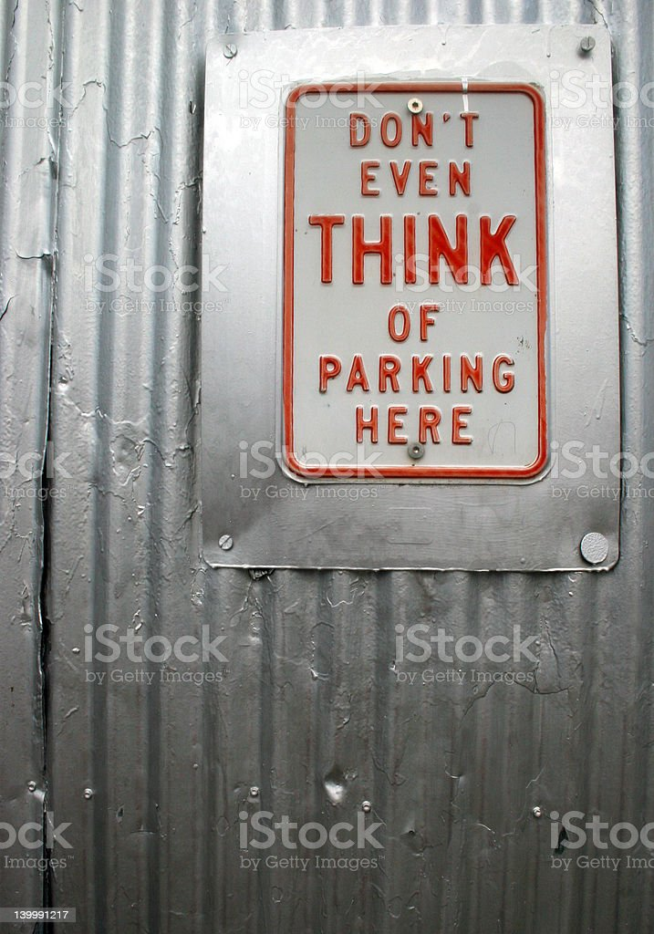 Warning sign against corrugated metal fence stock photo