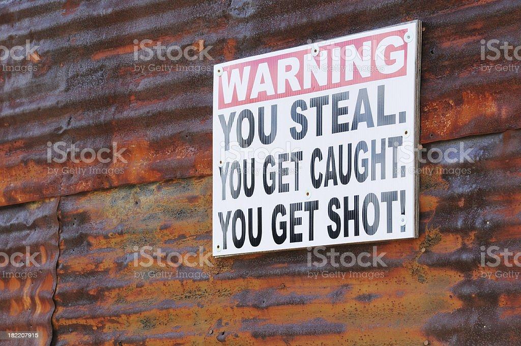 Warning sign agaist burglary stock photo