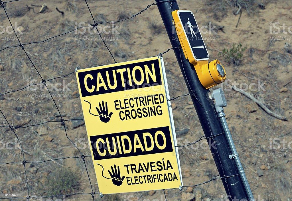 Warning sign at solar-powered crosswalk signal royalty-free stock photo