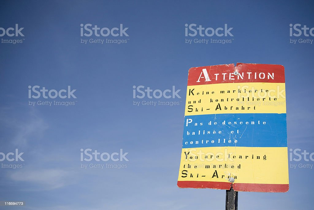 warning sign at the border of a ski area royalty-free stock photo