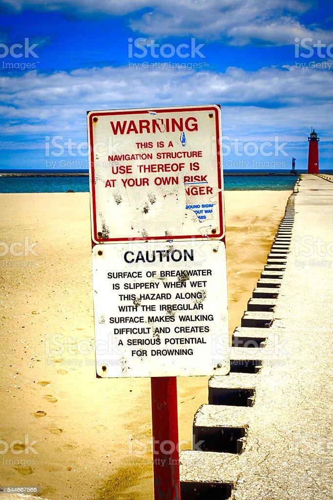 Warning sign at the Harbor pier in Kenosha Wisconsin stock photo