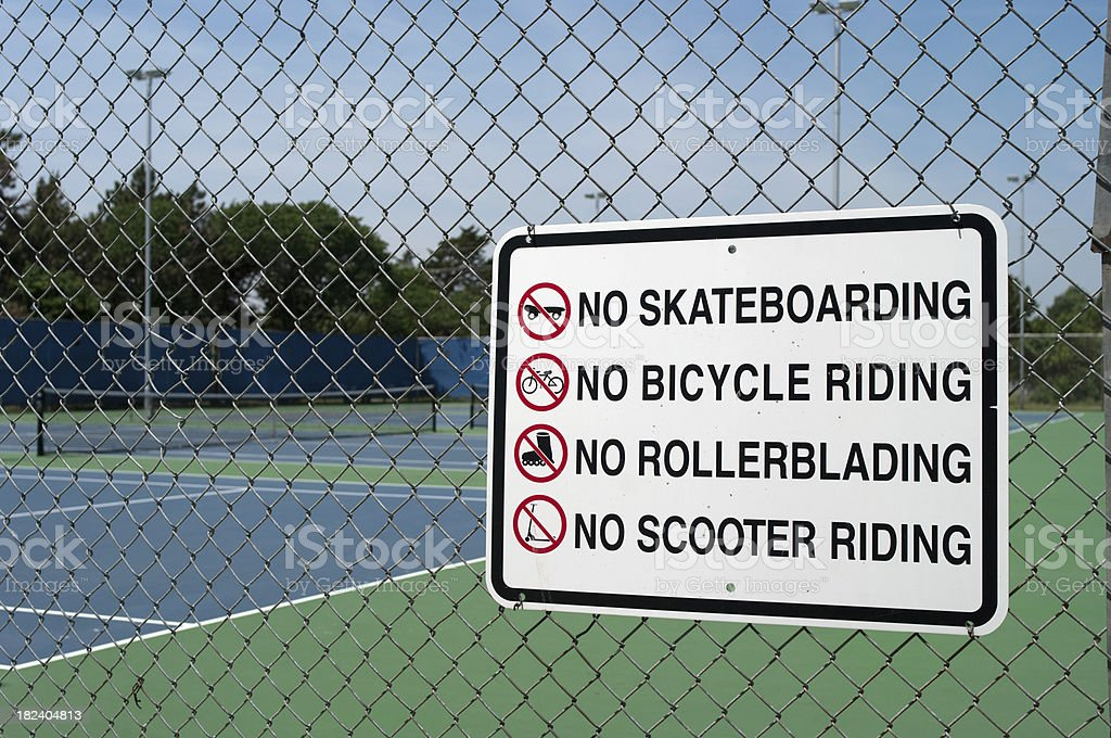 Warning Sign by Tennis Court stock photo
