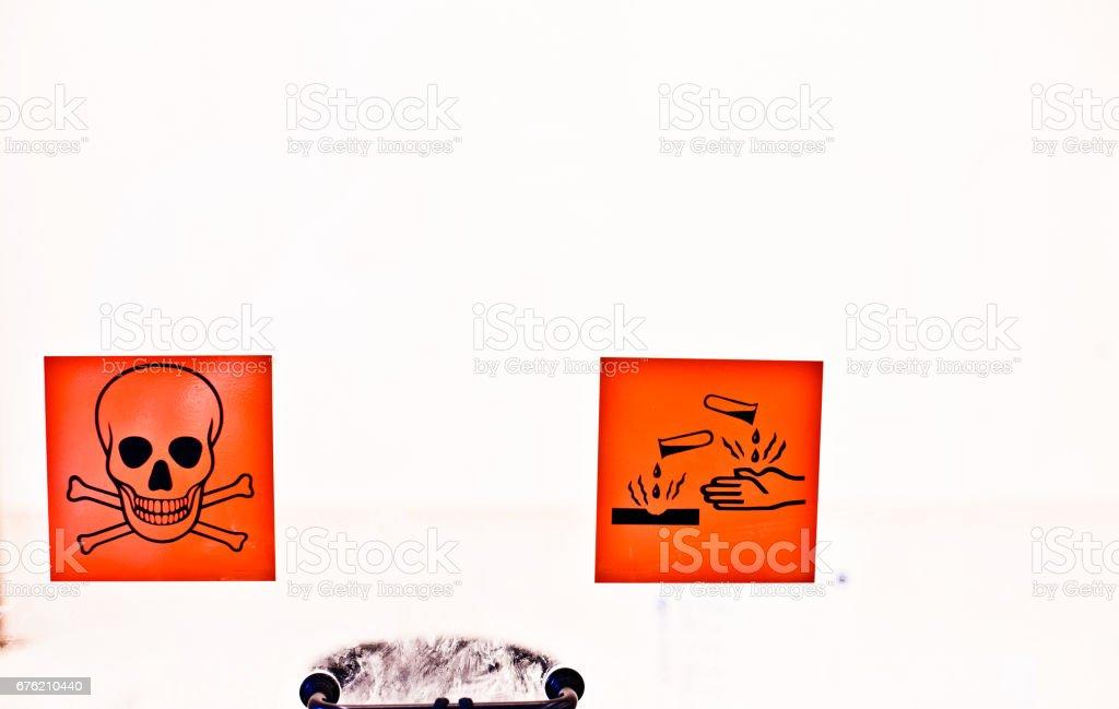 Warning Sign - Corrosive Chemical Chamber & Skull and Bones stock photo