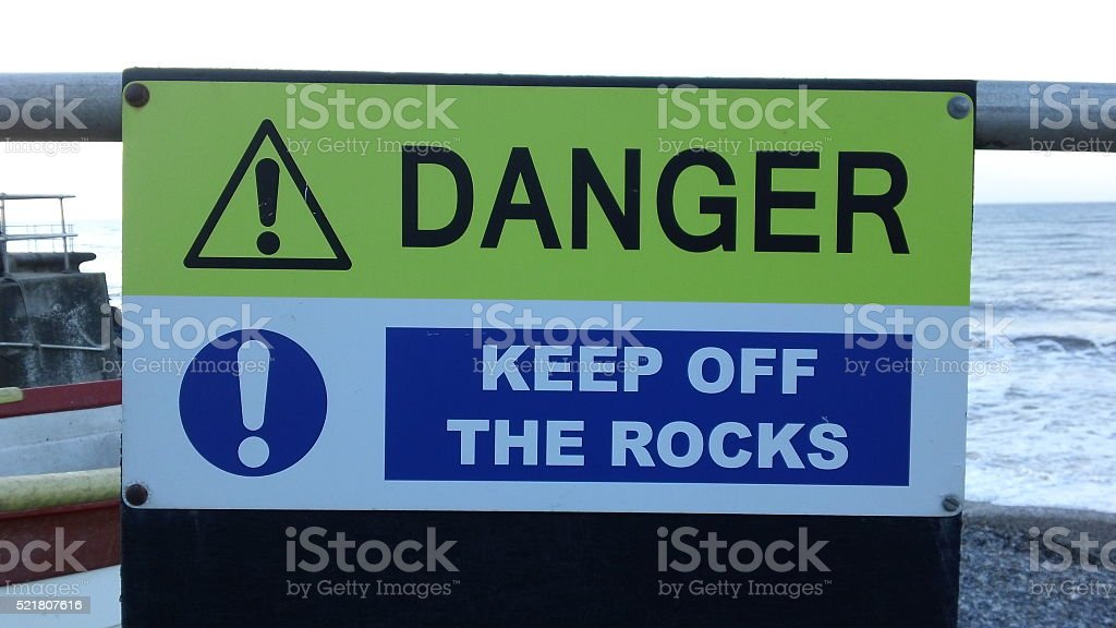 Warning sign - 'Danger Keep Off The Rocks' stock photo