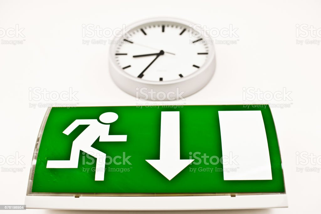 Warning Sign - Emergency Exit and Wall Clock stock photo