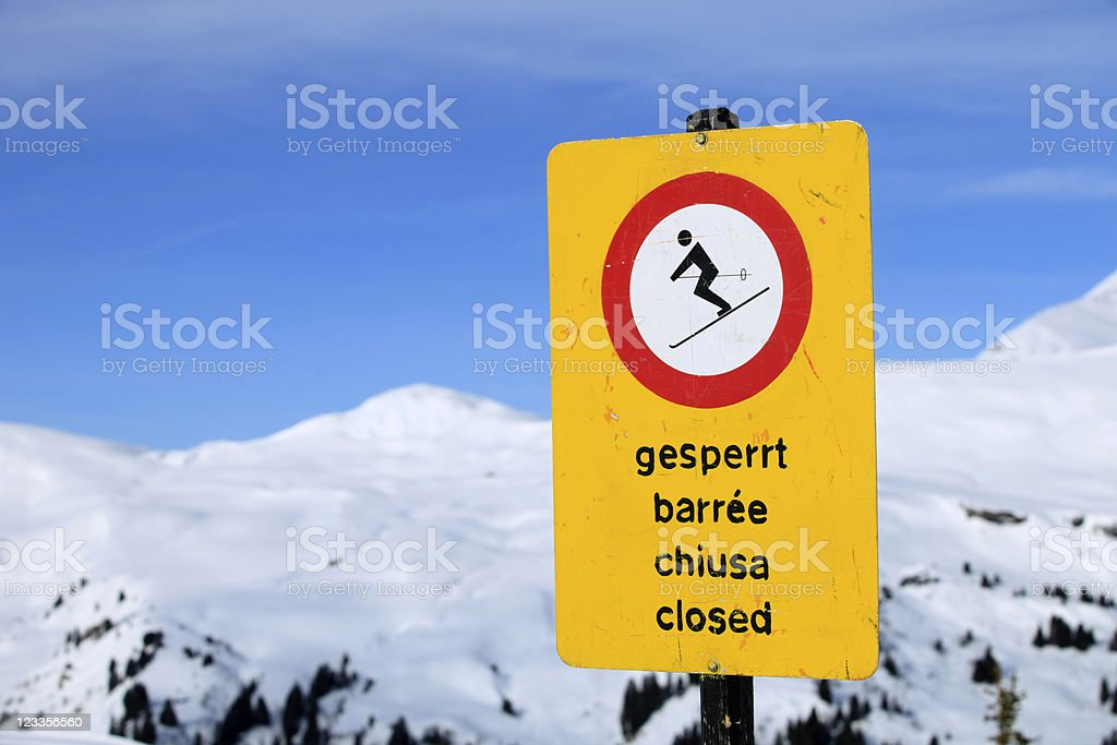 warning sign for a closed ski run in the Alps royalty-free stock photo
