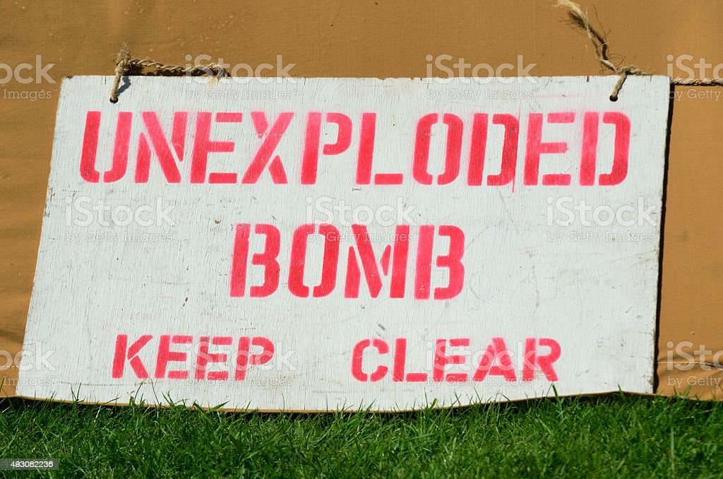 Warning sign for unexploded bomb stock photo