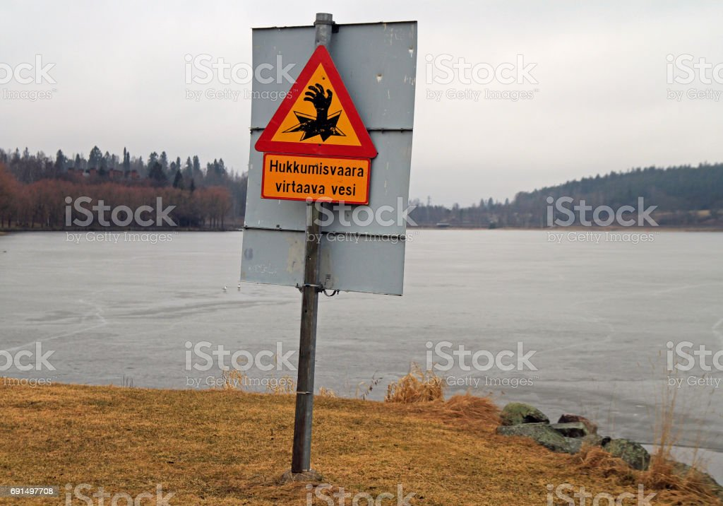 warning sign for walkers about quigmare nearly Hameenlinna castle stock photo