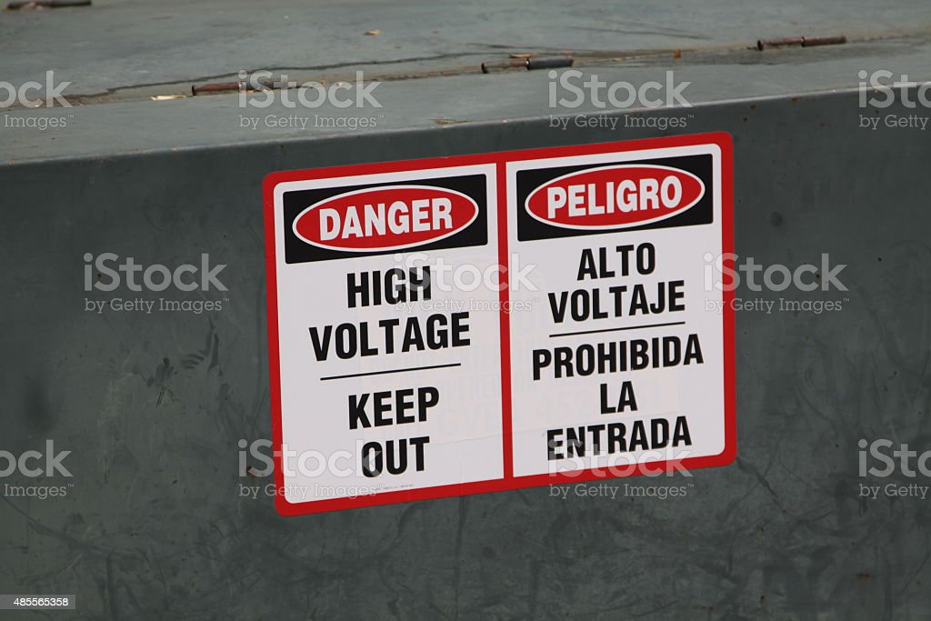Warning Sign In English And Spanish stock photo