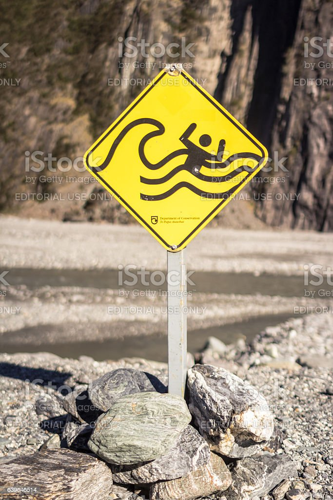 Warning sign in Fox Glacier stock photo