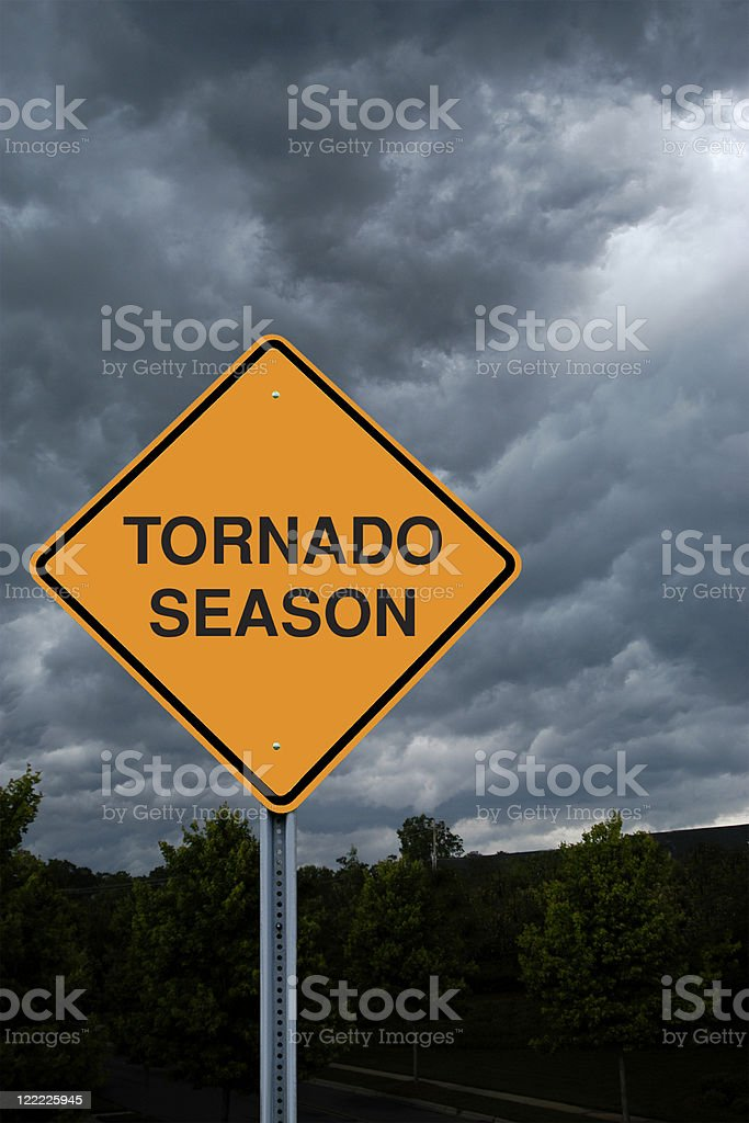 Warning Sign in Front of Storm Clouds royalty-free stock photo