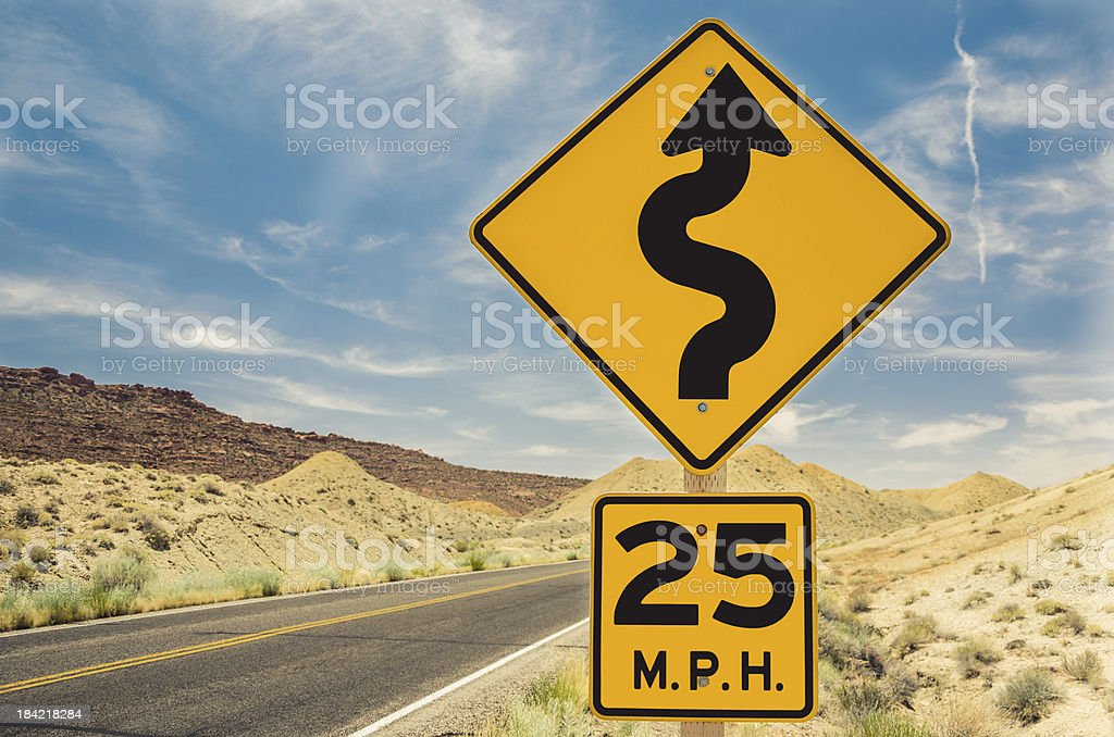 Warning Sign on a Curvy Road stock photo