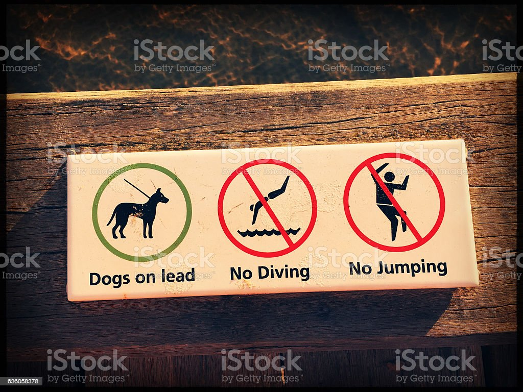 Warning sign on a wooden pier. stock photo