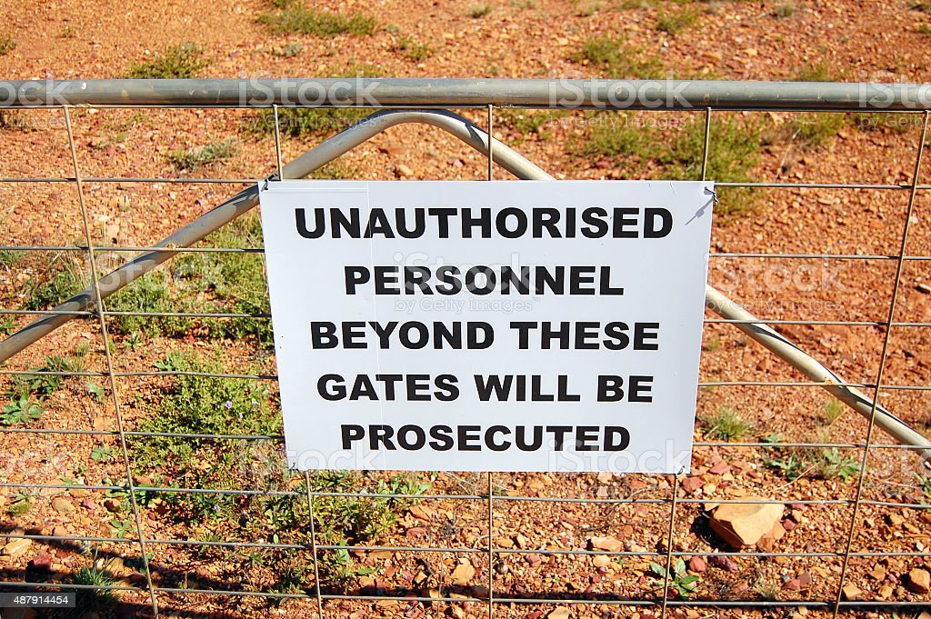 Warning sign on fence in Australia stock photo