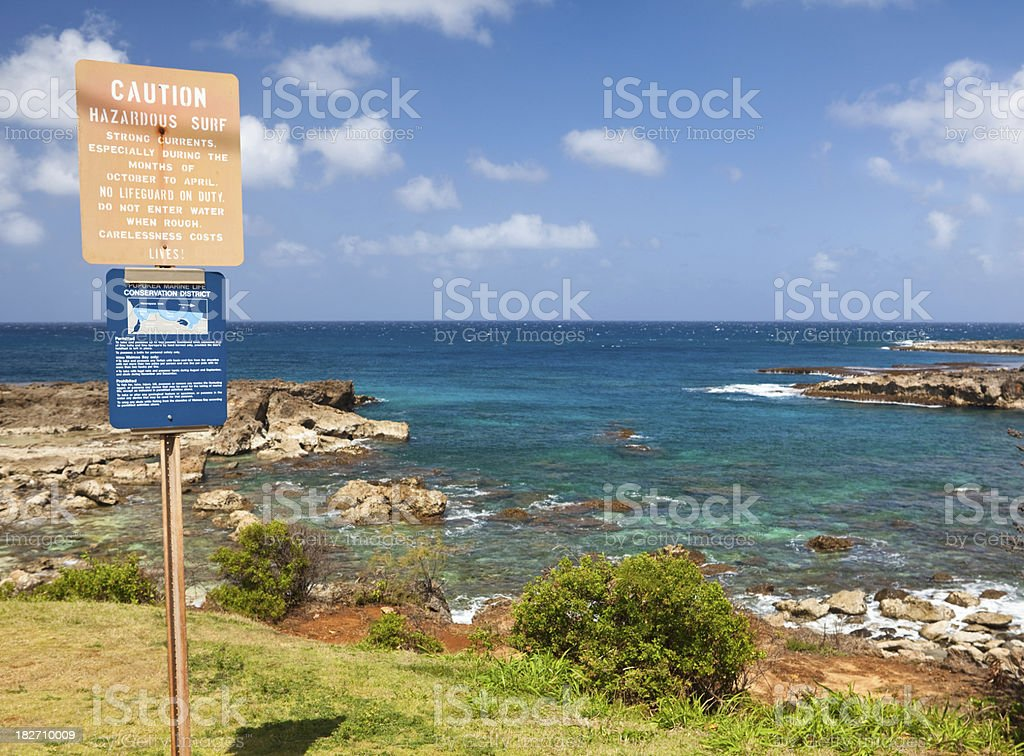 Warning sign on Hawaiian beach stock photo