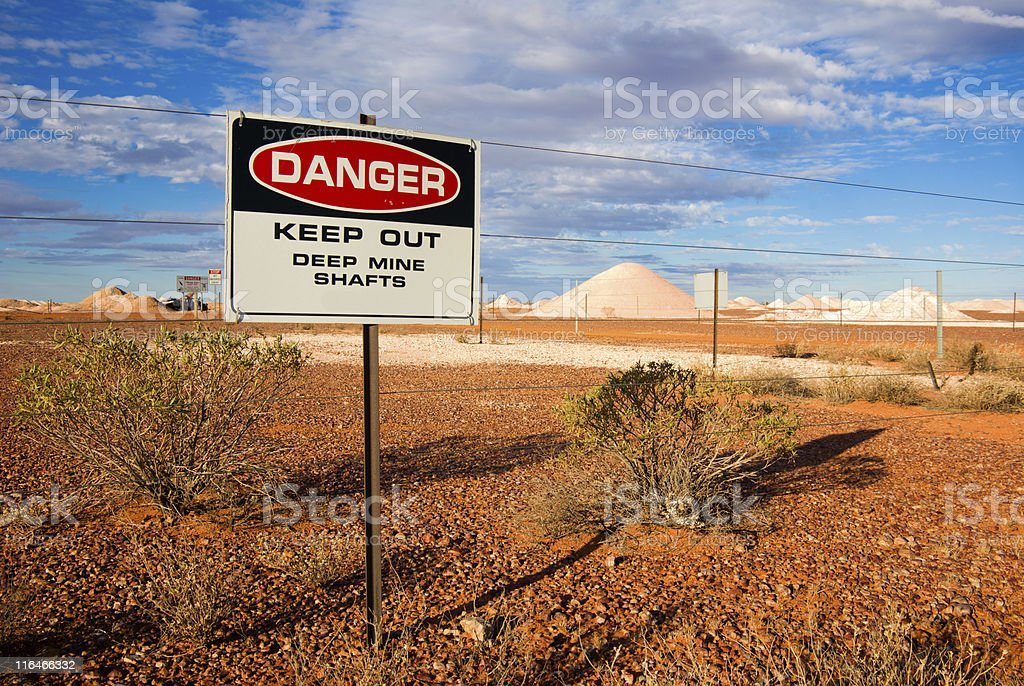 Warning sign on opal fields near Coober Pedy, outback Australia stock photo