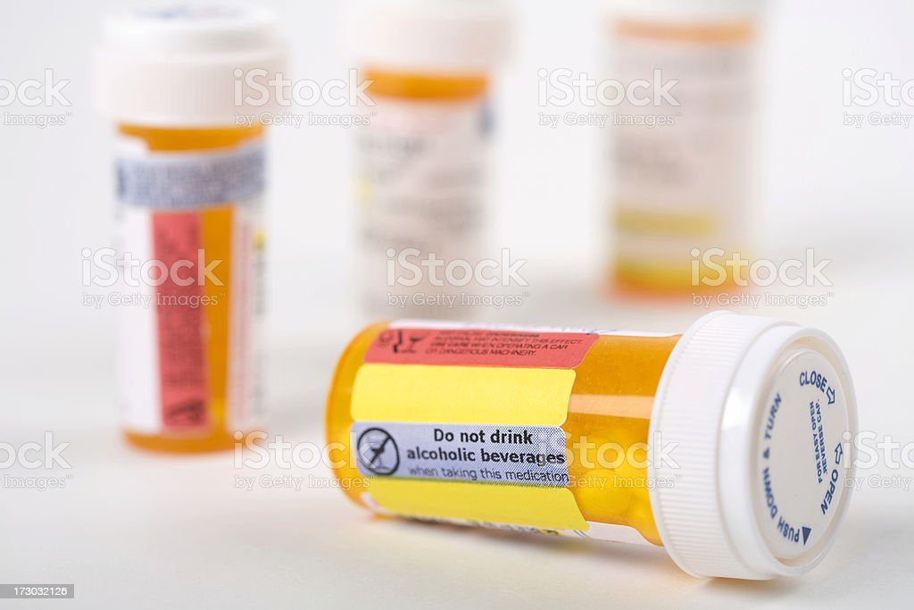 Warning sign on pill bottle royalty-free stock photo