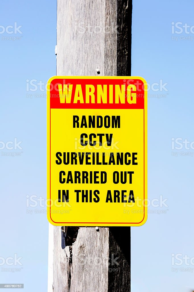 Warning sign security camera in use outdoor, copy space stock photo
