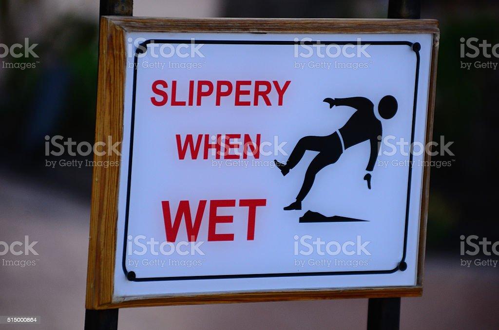 warning sign Slippery When Wet stock photo