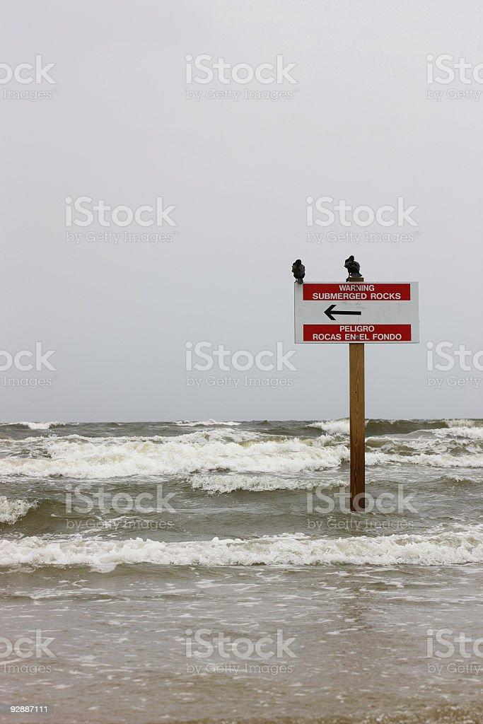 Warning sign 'submerged rocks' royalty-free stock photo