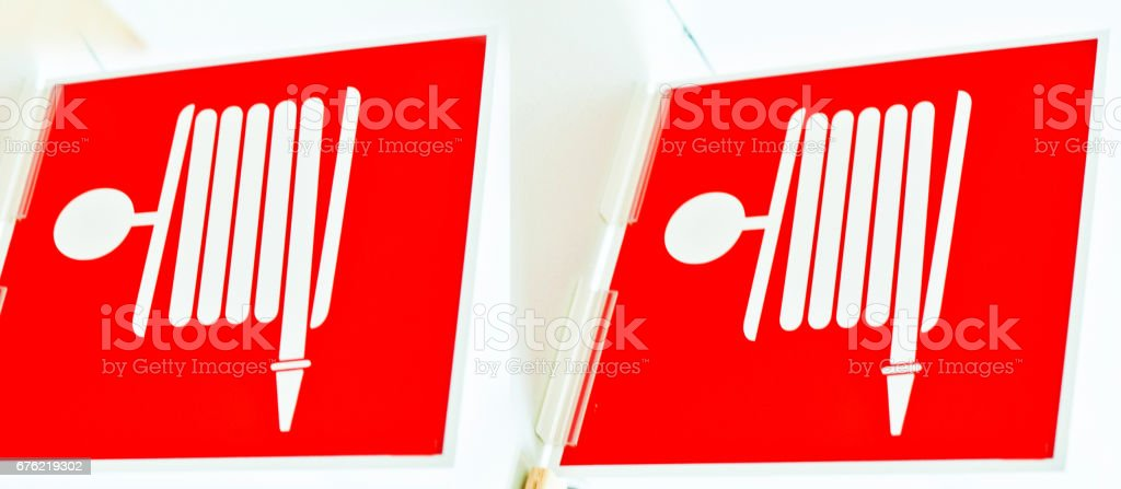 Warning Sign - Water Hose For Fire Outbreak stock photo