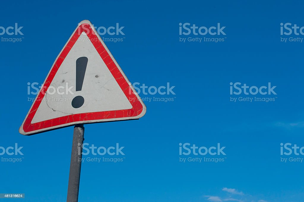 Warning sign with exclamation point stock photo