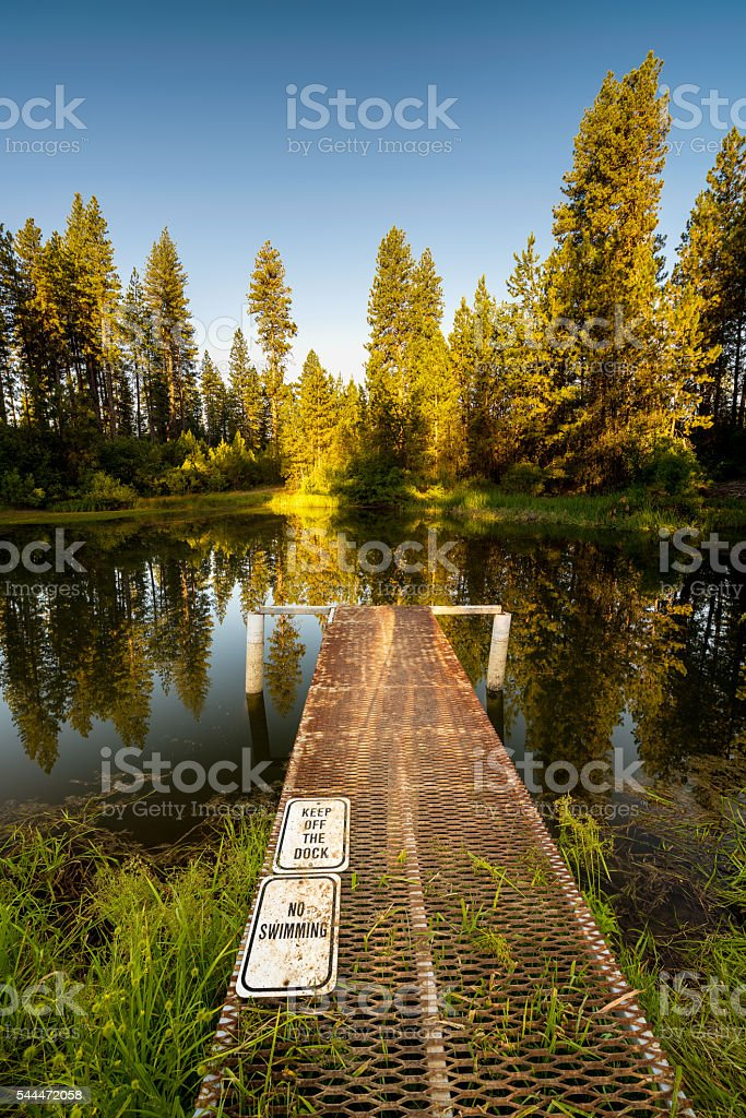 Warning signes on a mountain pond in the forest stock photo