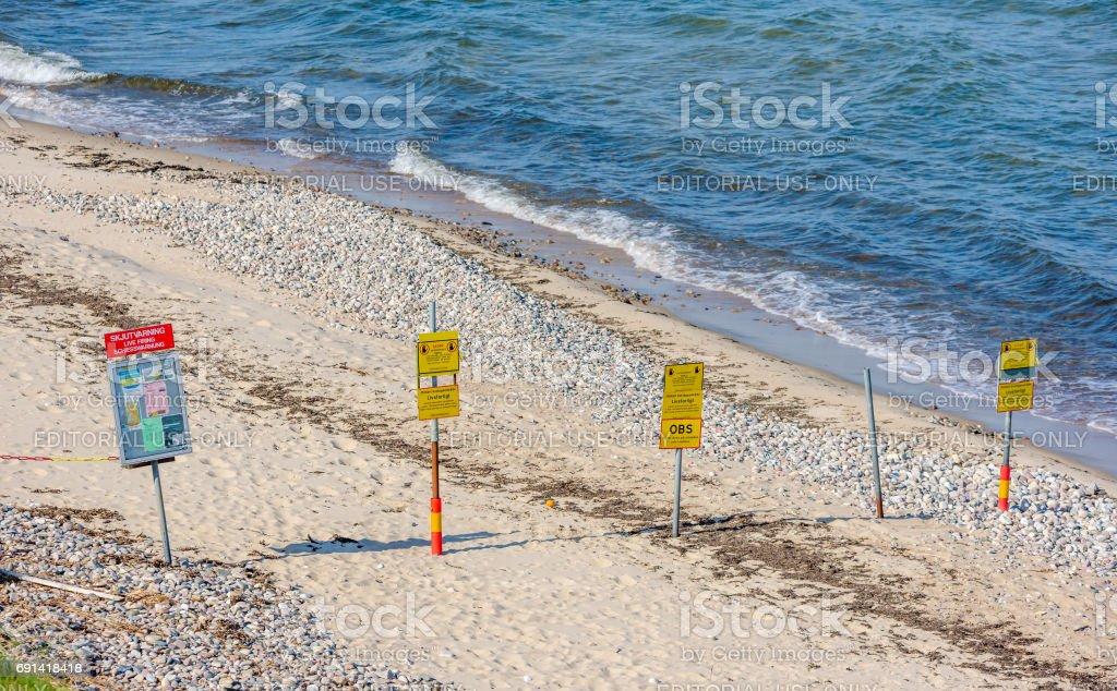 Warning signs at the beach stock photo