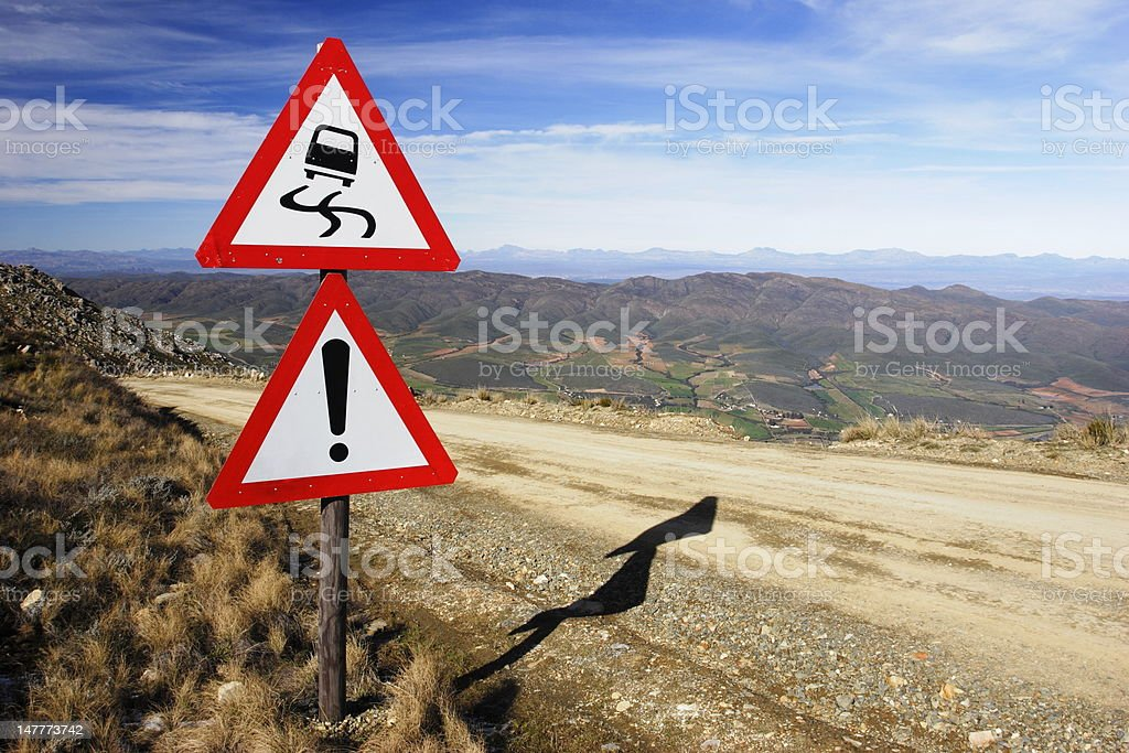 Warning signs on a mountain pass stock photo