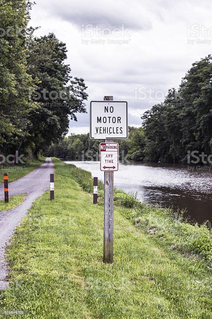 Warning Signs On Erie Canal Biking Walking Trail stock photo
