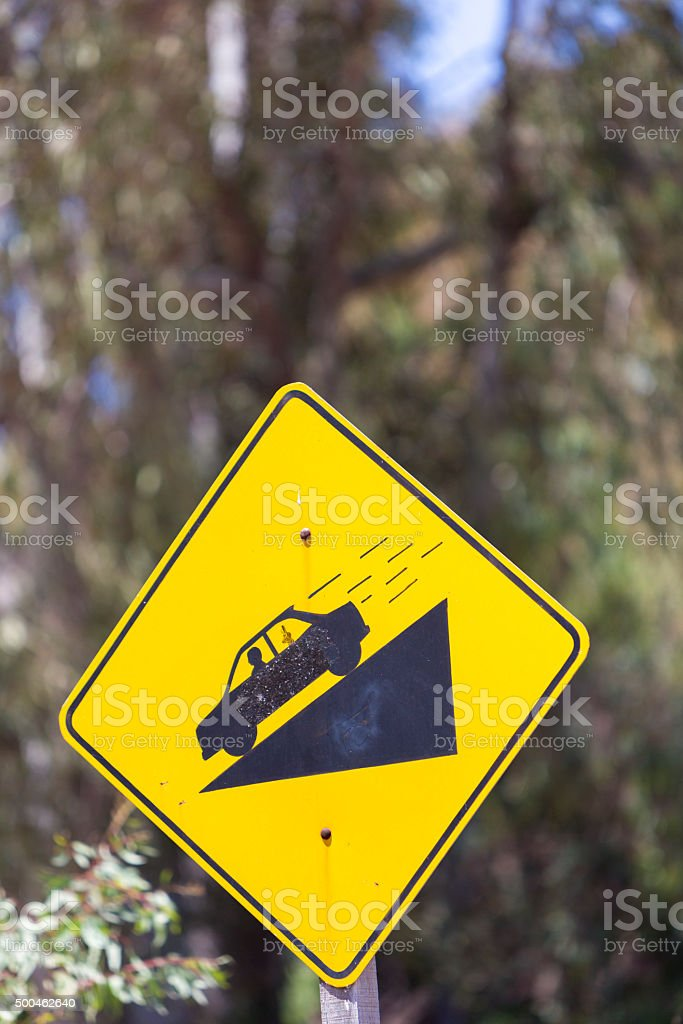 Warning steep road sign slope and car on hill, Argentina stock photo