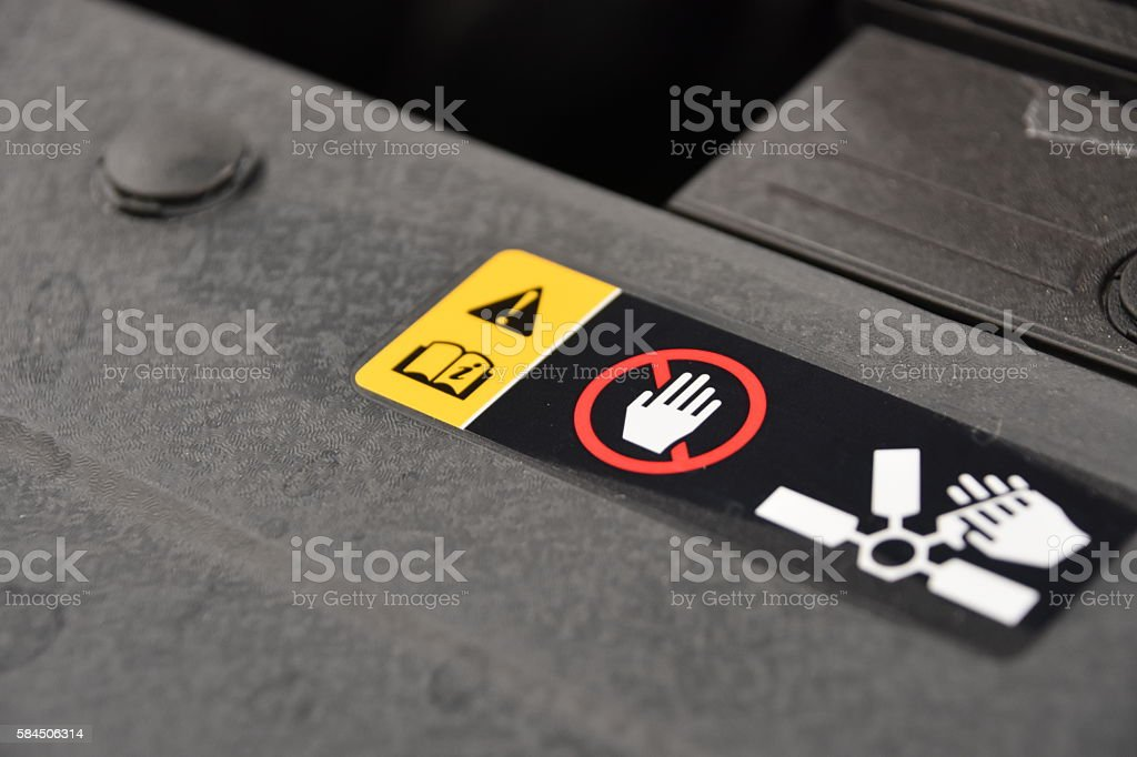Warning sticker in the car stock photo