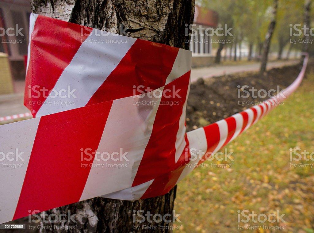 warning tape enclosing stock photo