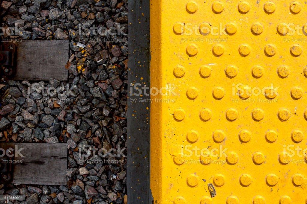 Warning tiles and railway track stock photo