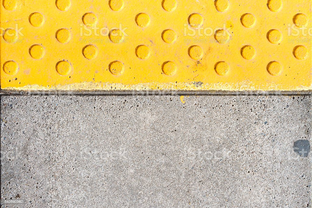Warning tiles on railway station stock photo