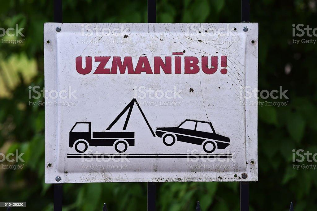 Warning tow away zone Latvian stock photo