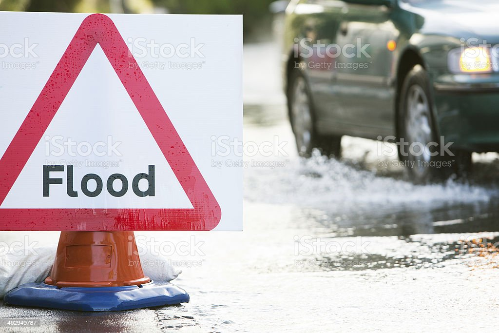 Warning Traffic Sign On Flooded Road royalty-free stock photo