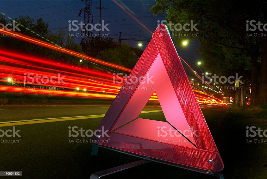 Warning triangle and motion blur background royalty-free stock photo